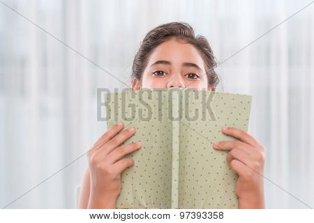 Hiding behind a book