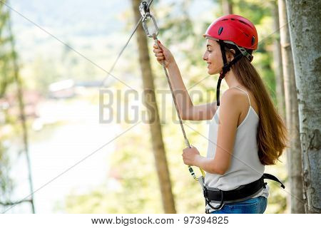 Woman riding on a zip line