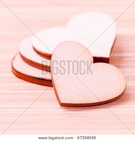 The Wooden Hearts On Wooden Background. - Concept For Love And Wedding .