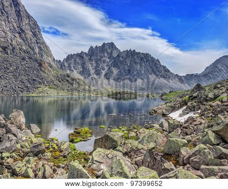 Huge Pieces Of Granite On The Lake In The Mountains Of Eastern Siberia