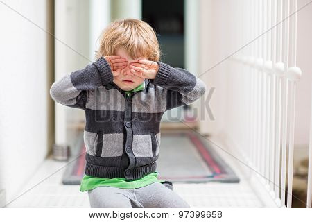 Little Kid Boy Crying At Home And Showing Sad Mood