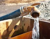 foto of groundwater  - pumping away fresh groundwater in a basin - JPG