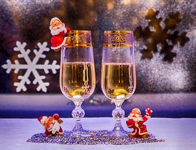 picture of gnome  - glasses of champagne Christmas trees Christmas toys gnome on the background of the winter window - JPG