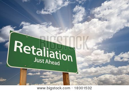 Retaliation Green Road Sign on Dramatic Blue Sky with Clouds.