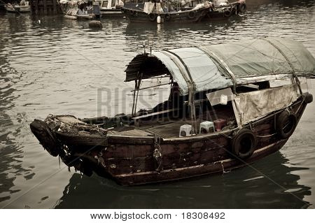 A Sampan Boat Floating In The Sea