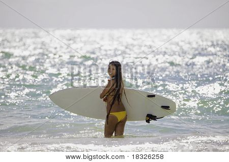 woman in yellow bikini surfing