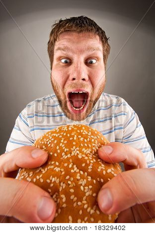 Man Eating Juicy Hamburger