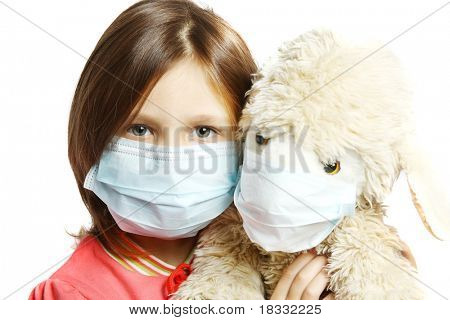 Little girl wearing a protective mask