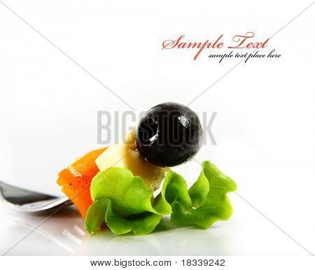 Freshly prepared salad served on a fork