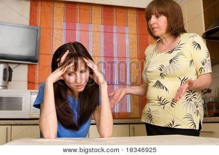 Conflict between mum and daughter at home. Search many conflicting people in my portfolio