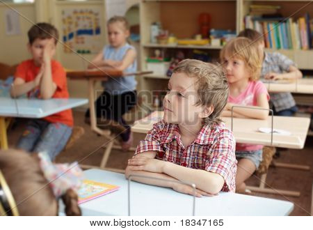 Children at a lesson in school