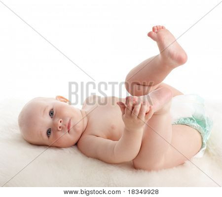 Happy baby laying on a soft rug
