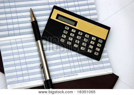 Check Book, transaction ledger, pen and calculator against a light background