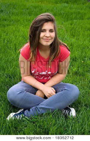 Teen Girl On A Grass
