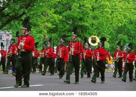 A group of band men playing at a local parade
