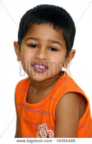 an handsome Indian kid not looking happy