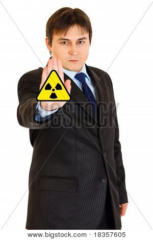 ?oncept-radiation hazard! Confident modern businessman showing stop gesture isolated on white