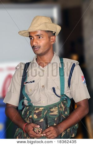 CHENNAI, INDIA - AUG: 22: An Indian security gusard posted at a train station in Chennai, India,  to patrol for terrorists on Aug. 22, 2009.