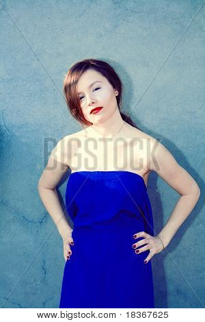 Portrait Of A Beautiful Woman In Blue Dress