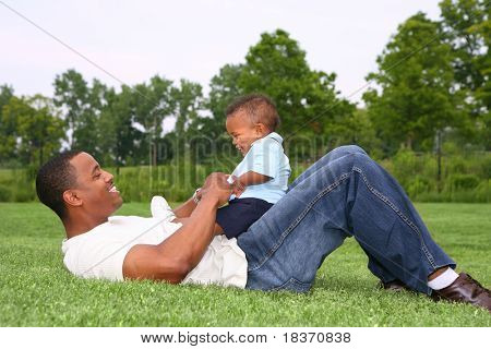 Father and Son Playing Outdoor Park in Summer