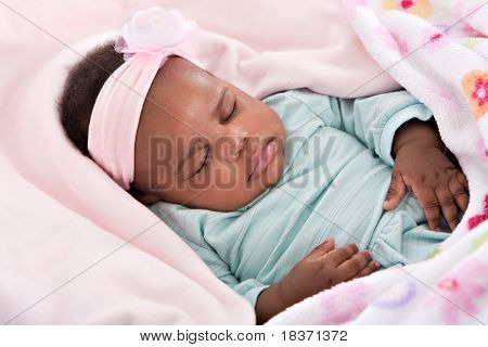 Closeup of 3 Month Old Little Baby African American Girl Sleeping in Cradle