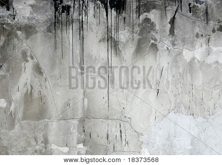 concrete wall with tar drips