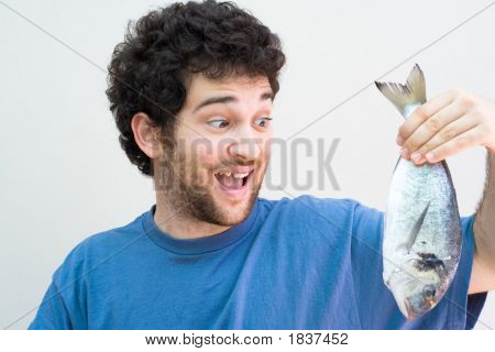 Crazy Man Holding A Fish