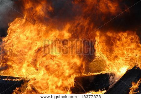 Big burning fire with black smoke