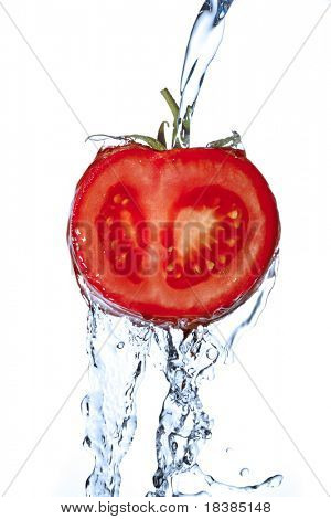 close up of a tomato with pouring water