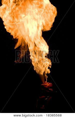 LOULE, PORTUGAL - JUNE 26:fire eater  performs onstage at Festival Med June 26, 2008 in Loule, Portugal.