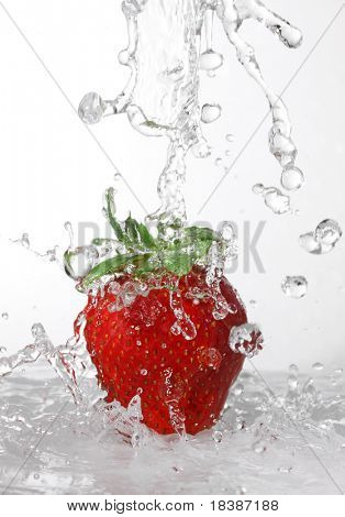 water being poured in a strawberry light gray background