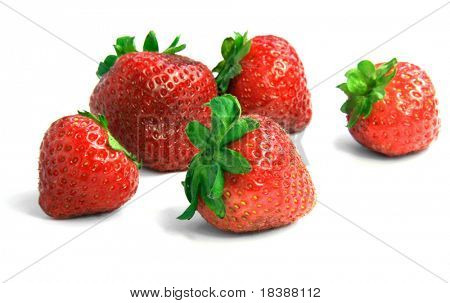 Strawberries over white background.