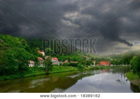 View on river and green hills of Karlstejn village near Prague, Czech Republic.