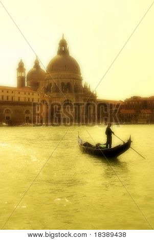 Gondola on Grand Canal in front of Santa Maria della Salute church in Venice.