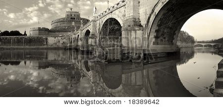 Panorama of famous Saint Angel castle and bridge over the Tiber river in Rome, Italy (sepia toned).