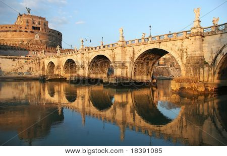 View on famous Saint Angel castle and bridge over the Tiber river in Rome, Italy.