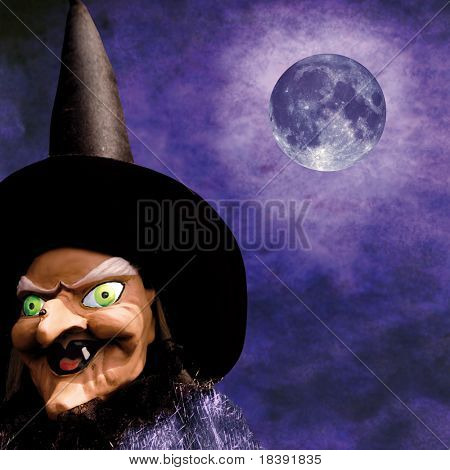 scary halloween witch on grunge purple background and full moon