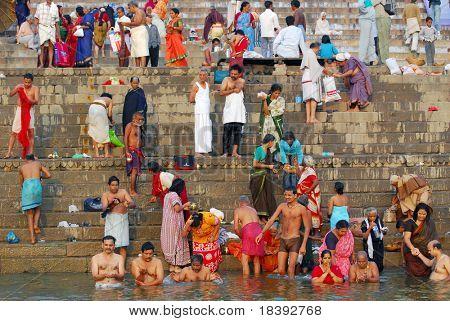 hindu men and women, bathing in holy ganges in varanasi