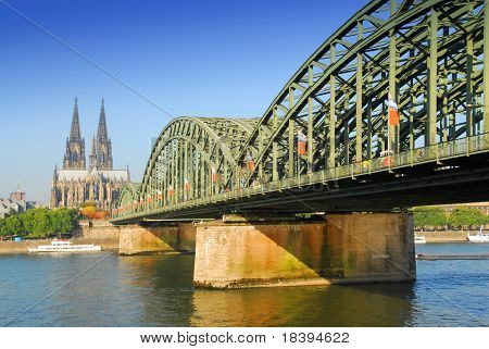 View on the 'dom' cathedral and the 'hohenzollern' railway bridge over river rhine in Cologne, Germany