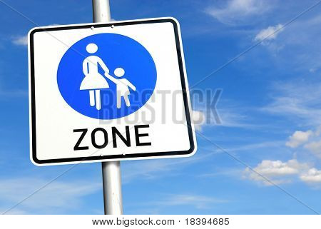 Traffic sign for women and children friendly zone with blue sky background