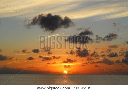 Sunset or sunrise over the ocean at Maria la Gorda beach, Cuba