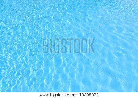 blue background with sun reflected in the swimming-pool water