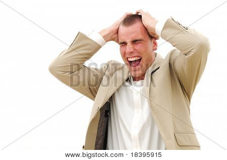 Businessman screaming with hands on his head, isolated on white
