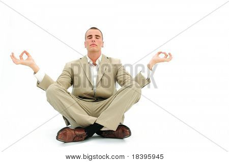 Businessman sitting in lotus position to get rid of office stress, isolated on white background