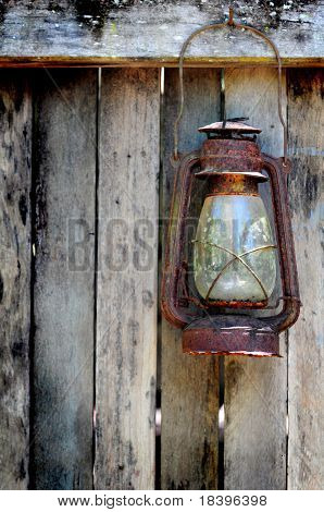 Grunge wooden background with vintage lamp from a western style cottage in Australia
