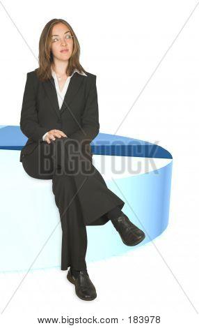 Business Woman Sitting On Pie Chart Closeup