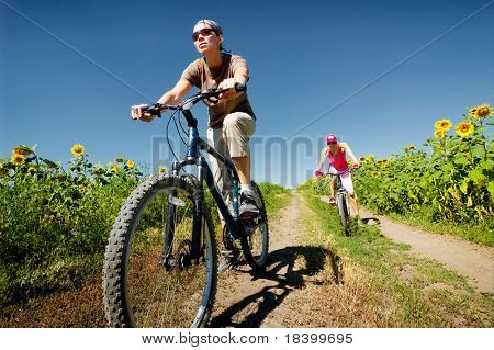 women relax biking on summer road