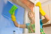 picture of house cleaning  - Women cleaning a window 4 - JPG