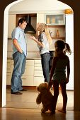 picture of conflict couple  - Child looks at the swearing parents - JPG