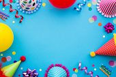 Birthday party background with party hats and streamers poster